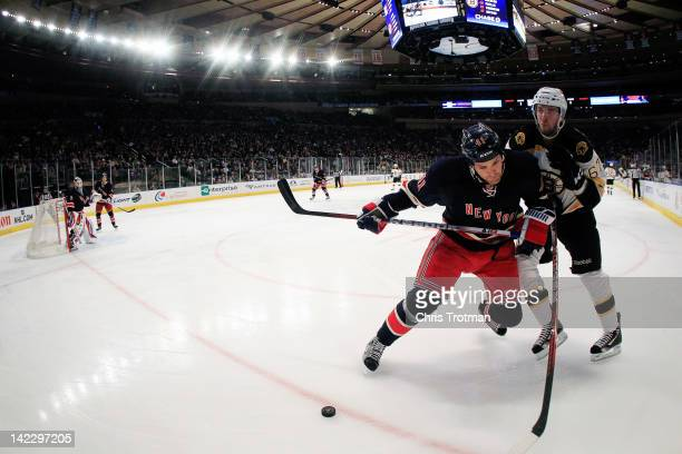 Stu Bickel of the New York Rangers is challenged by Benoit Pouliot of the Boston Bruins at Madison Square Garden on April 1 2012 in New York City