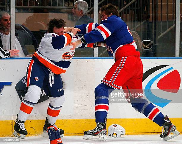 Stu Bickel of the New York Rangers fights with Michael Haley of the New York Islanders during an NHL hockey game at Madison Square Garden on December...