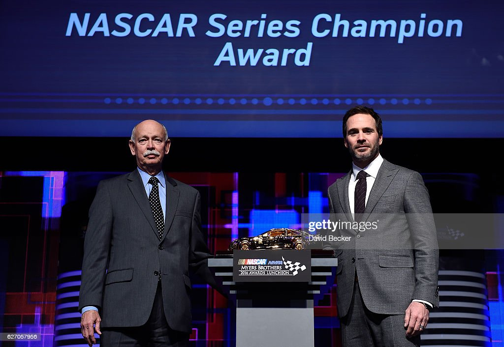 Stu Grant, General Manager, Global Racing Tires, Goodyear, and Jimmie Johnson, driver of the #48 Chevrolet and NASCAR Sprint Cup Series Champion, pose with the Goodyear NASCAR Series Champion Award during the NASCAR NMPA Myers Brothers Awards Luncheon at The Wynn on December 1, 2016 in Las Vegas, Nevada.