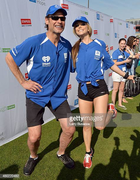 Stu Grimson and Lindsay Ell attend the City of Hope Celebrity Softball Game during the CMA Festival at Greer Stadium on June 7 2014 in Nashville...