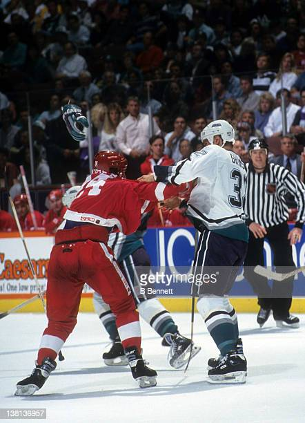 Stu Grimson of the Mighty Ducks of Anaheim fights Bob Probert of the Detroit Red Wings during their game on October 8 1993 at the Arrowhead Pond of...