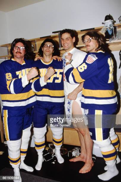 Stu Grimson of the Mighty Ducks of Anaheim poses for a portrait with the Hanson Brothers from the movie Slapshot Jack Hanson Steve Hanson and Jeff...