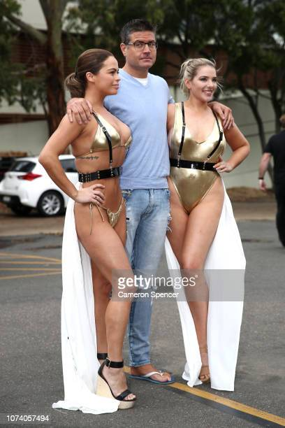 Stu Laundy poses with Watermark Swimwear ring girls prior to a press conference at The Loaves Fishes at the Ashfield Uniting Church ahead of his...