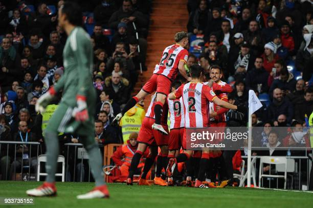 Stuani #7 of Girona celebrates after scoring his team's first goal during the La Liga match between Real Madrid v Girona at Santiago Bernabeu on...