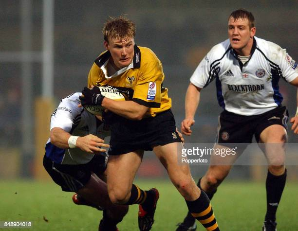 Stuart Abbott of London Wasps is tackled by Olly Barkley of Bath watched by Mike Tindall during the Zurich Premiership match between Bath and London...