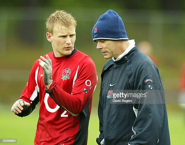 Stuart Abbott talks to England Coach Clive Woodward during England rugby union training June 6 at Porirua Trust Park Wellington New Zealand