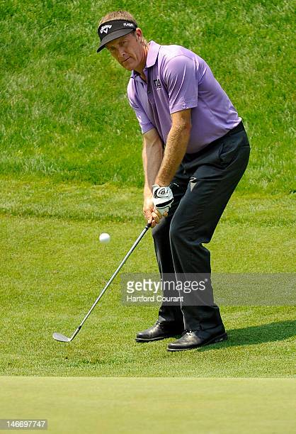 Stuart Appleby chips onto the 18th green during the second round of the 2012 Travelers Championship golf tournament at the TPC River Highlands in...
