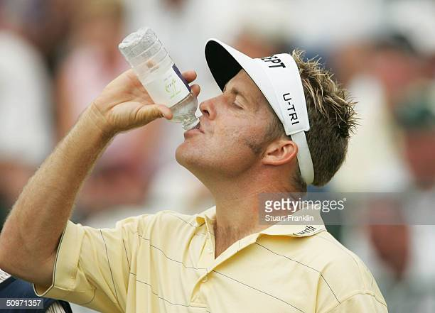 Stuart Appleby of Australia drinks water on the seventh tee during the first round of the 104th US Open at Shinnecock Hills Golf Club on June 17 2004...