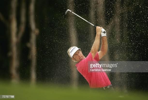 Stuart Appleby of Australia plays a bunker shot during round one of the Australian PGA Championships at the Hyatt Regency Coolum December 7, 2006 in...