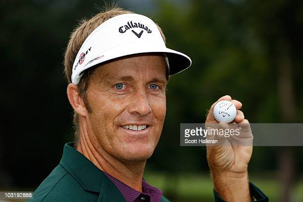 Stuart Appleby of Australia poses with his golf ball after he finished with an 11under par 59 during the final round of the Greenbrier Classic on The...