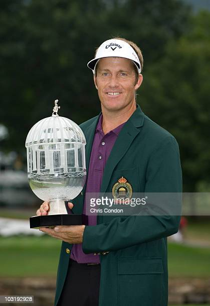 Stuart Appleby of Australia poses with the tournament tropy after scoring a 59 and winning The Greenbrier Classic at The Greenbrier Resort on August...