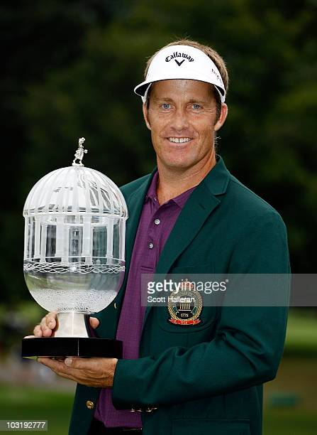 Stuart Appleby of Australia poses with the winner's trophy after his victory at the Greenbrier Classic on The Old White Course at the Greenbrier...