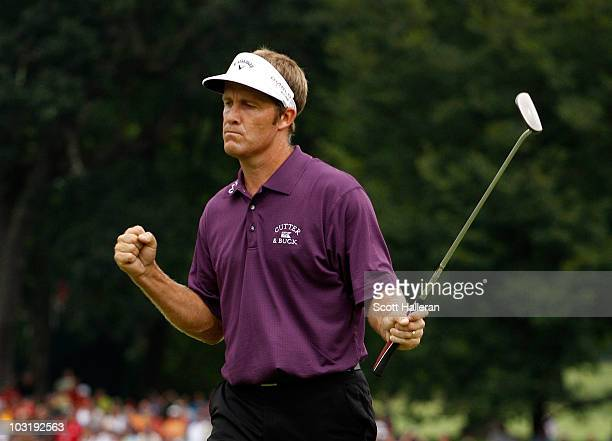 Stuart Appleby of Australia reacts after his birdie putt on the 18th green to finish with an 11under par 59 during the final round of the Greenbrier...