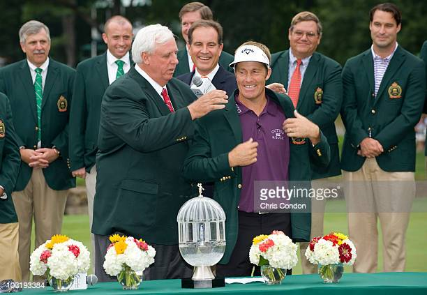 Stuart Appleby of Australia receives the winner's jacket from tournament host Jim Justice and the trophy after scoring a 59 and winning The...