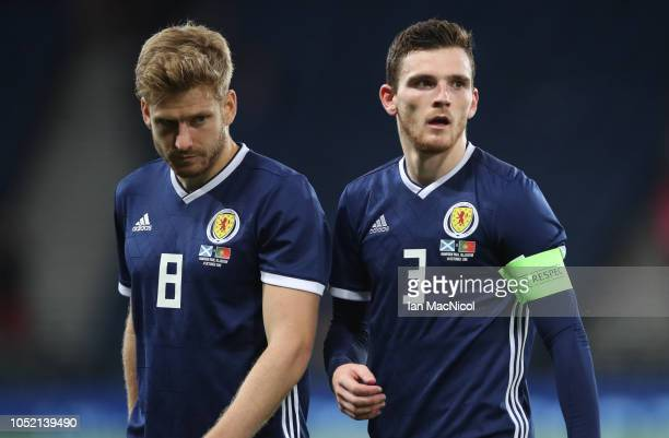 Stuart Armstrong and Andy Robertson of Scotland leave the pitch during the International Friendly match between Scotland and Portugal on October 14...