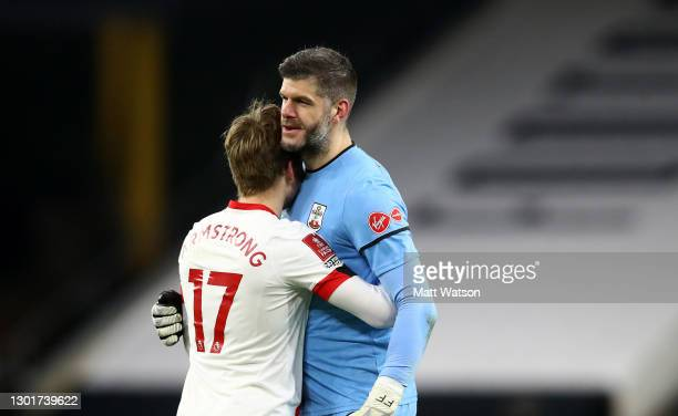 Stuart Armstrong and Fraser Forster of during The Emirates FA Cup Fifth Round match between Wolverhampton Wanderers and Southampton at Molineux on...