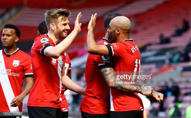 Stuart Armstrong and Nathan Redmond of Southampton celebrate during the Premier League match between Southampton and Burnley at St Mary's Stadium on...