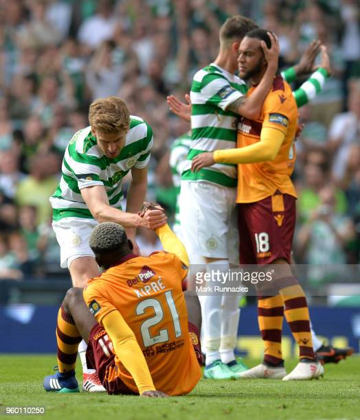 Stuart Armstrong of Celtic helps dejected Cedric Kipre of Motherwell following the Scottish Cup Final between Motherwell and Celtic at Hampden Park...
