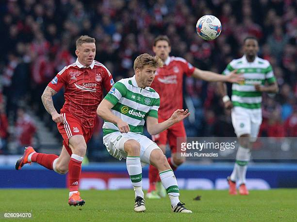Stuart Armstrong of Celtic is tackled by chased down by Jonny Hayes of Aberdeen during the Betfred Cup Final between Aberdeen FC and Celtic FC at...