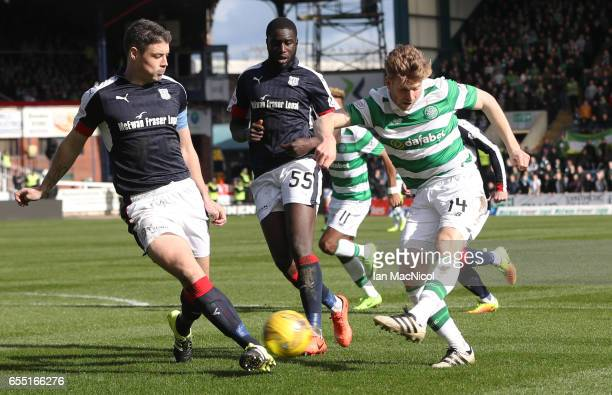 Stuart Armstrong of Celtic shoots at goal during the Ladbrokes Scottish Premiership match between Dundee and Celtic at Dens Park Stadium on March 19...