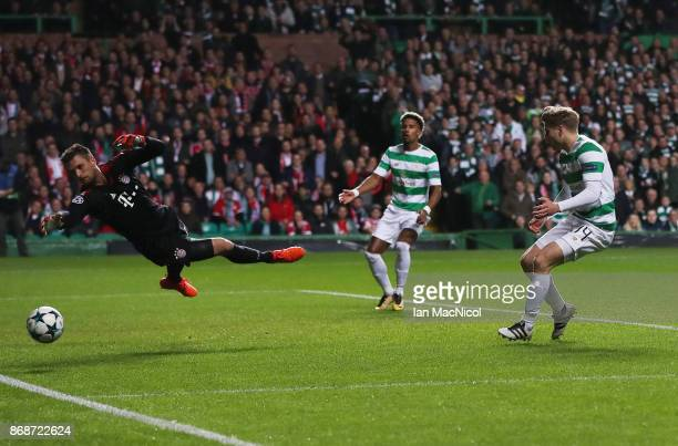 Stuart Armstrong of Celtic shoots at goal during the UEFA Champions League group B match between Celtic FC and Bayern Muenchen at Celtic Park on...