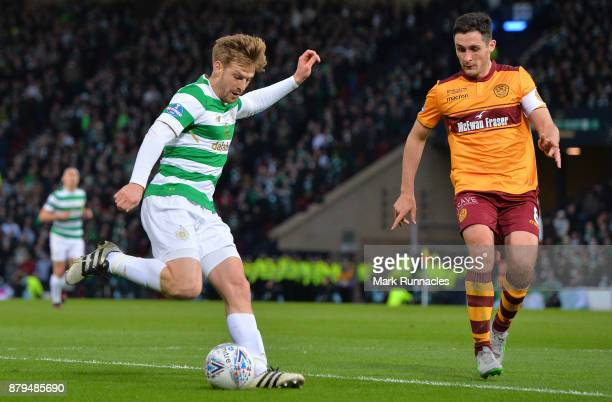 Stuart Armstrong of Celtic takes on Carl McHugh of Motherwell during the Betfred League Cup Final between Celtic and Motherwell at Hampden Park on...