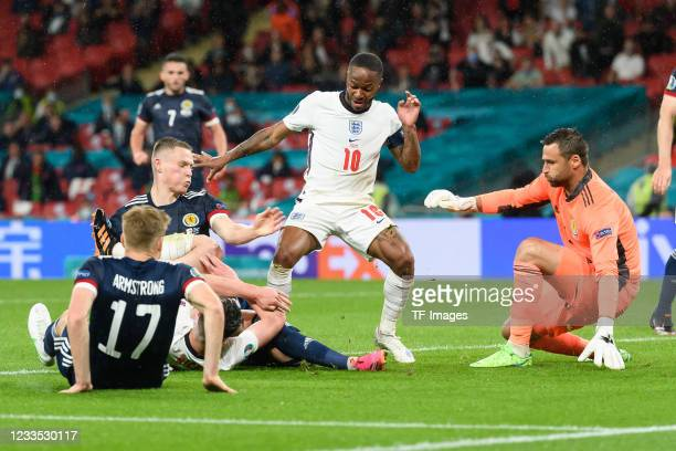 Stuart Armstrong of Scotland and Raheem Sterling of England and goalkeeper David Marshall of Scotland battle for the ball during the UEFA Euro 2020...