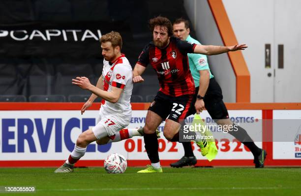 Stuart Armstrong of Southampton and Ben Pearson of Bournemouth during the Emirates FA Cup Quarter Final match between AFC Bournemouth and Southampton...