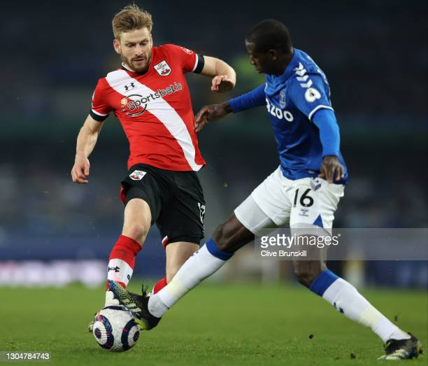 Stuart Armstrong of Southampton battles for possession with Abdoulaye Doucoure of Everton during the Premier League match between Everton and...