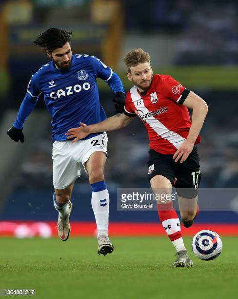 Stuart Armstrong of Southampton battles for possession with Andre Gomes of Everton during the Premier League match between Everton and Southampton at...