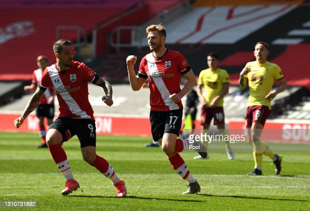 Stuart Armstrong of Southampton celebrates with teammate Danny Ings after scoring their team's first goal during the Premier League match between...