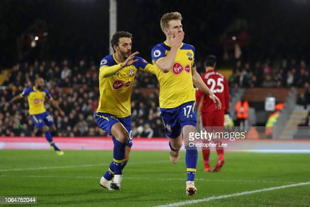 Stuart Armstrong of Southampton celebrates with teammate Manolo Gabbiadini after scoring his team's second goal during the Premier League match...