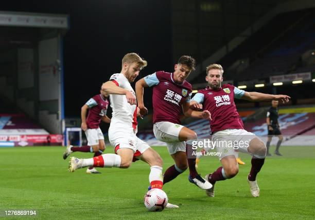 Stuart Armstrong of Southampton is closed down by Ashley Westwood and Charlie Taylor of Burnley during the Premier League match between Burnley and...