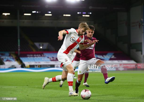 Stuart Armstrong of Southampton is closed down by Ashley Westwood of Burnley during the Premier League match between Burnley and Southampton at Turf...