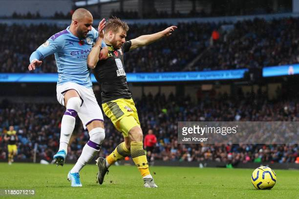 Stuart Armstrong of Southampton is tackled by Kyle Walker of Manchester City during the Premier League match between Manchester City and Southampton...