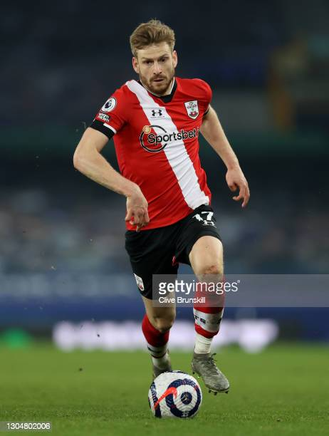 Stuart Armstrong of Southampton runs with the ball during the Premier League match between Everton and Southampton at Goodison Park on March 01, 2021...
