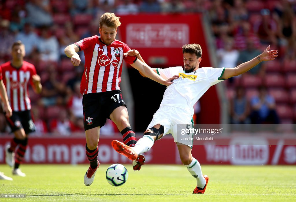 Stuart Armstrong of Southampton tackles with Tobias Strobl of Borussia Monchengladbach during the pre-season friendly match between Southampton and Borussia Monchengladbach at St Mary's Stadium on August 4, 2018 in Southampton, England.