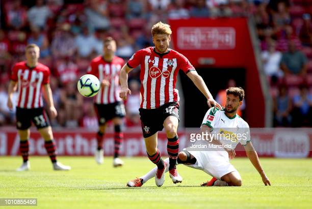 Stuart Armstrong of Southampton tackles with Tobias Strobl of Borussia Monchengladbach during the preseason friendly match between Southampton and...