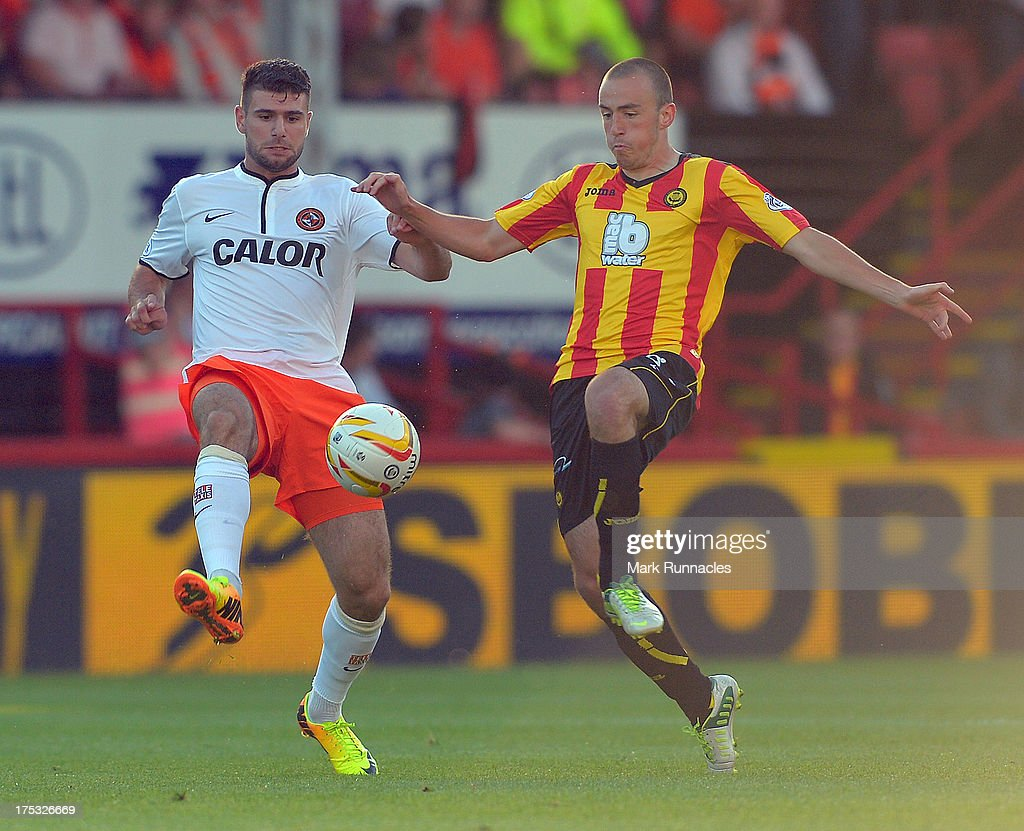 Stuart Bannigan of Partick Thistle and Nadir Ciftci of Dundee United in action during the Scottish Premiership League match between Partick Thistle and Dundee United at Firhill Stadium on August 02, 2013 in Glasgow, Scotland.