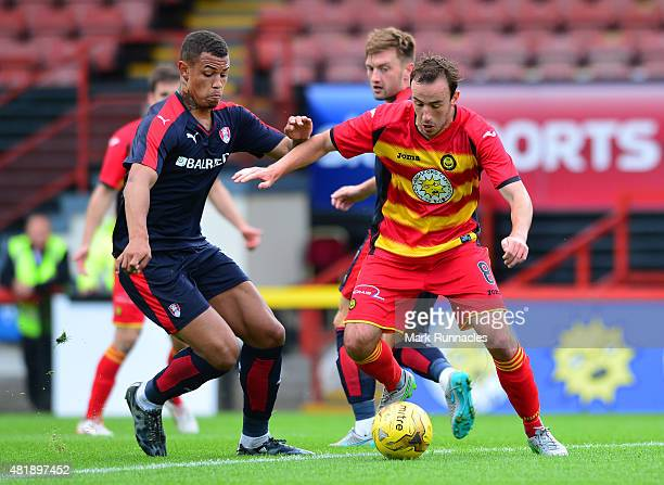 Stuart Bannigan of Patrick Thistle challenges with Jonson ClarkeHarris of Rotherham during a pre season friendly match between Patrick Thistle FC and...