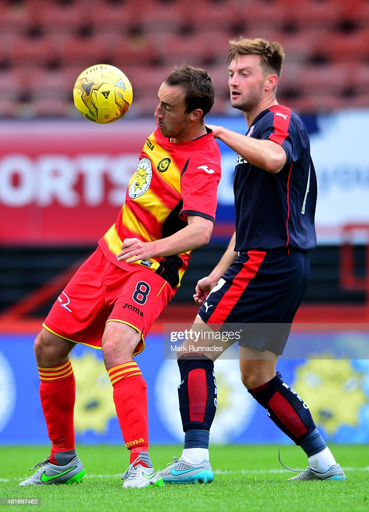 Stuart Bannigan of Patrick Thistle challenges with Lee Frecklington of Rotherham during a pre season friendly match between Patrick Thistle FC and Rotherham United at Firhill Stadium on July 25, 2015 in Glasgow, Scotland.