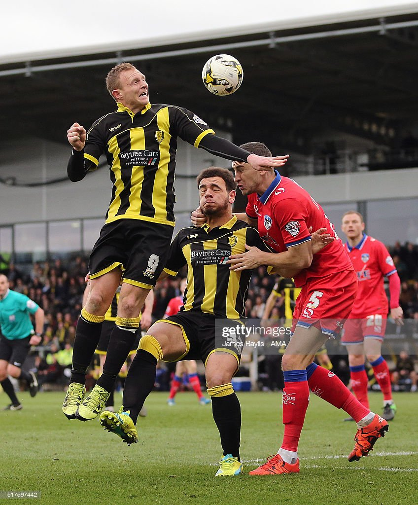 Stuart Beavon of Burton Albion and James Wilson of Oldham Athletic during the Sky Bet League One match between Burton Albion and Oldham Athletic at Pirelli Stadium on March 26, 2016 in Burton-upon-Trent, England.