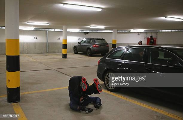 Stuart Benson of the Great Britain Bobsleigh Team warms up in an underground garage prior to heat one of the four man bobsleigh during the Viessmann...
