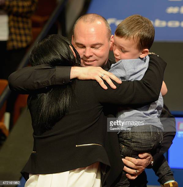 Stuart Bingham celebrates with wife Michelle and son Shae after beating Shaun Murphy in the final of the 2015 Betfred World Snooker Championship at...