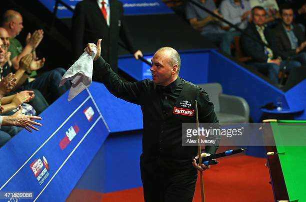 Stuart Bingham gives a thumbs up to the crowd after victory over Ronnie O'Sullivan on day twelve of the 2015 Betfred World Snooker Championship at...