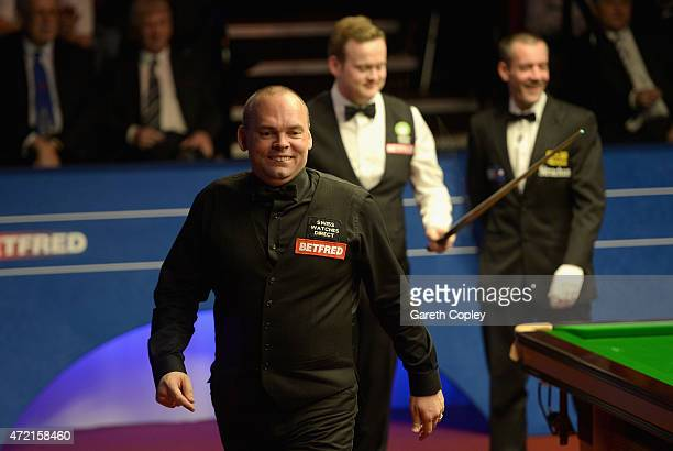 Stuart Bingham leaves the arena for a midframe toilet break during the final of the 2015 Betfred World Snooker Championship at Crucible Theatre on...