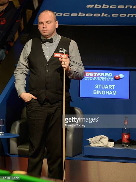 Stuart Bingham lines up a shot against Judd Trump during their semi final on day fifteen of the 2015 Betfred World Snooker Championship at Crucible...