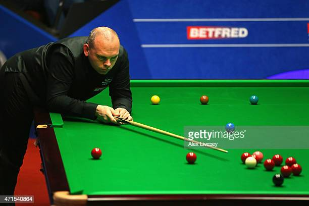 Stuart Bingham lines up a shot against Ronnie O'Sullivan during day twelve of the 2015 Betfred World Snooker Championship at Crucible Theatre on...