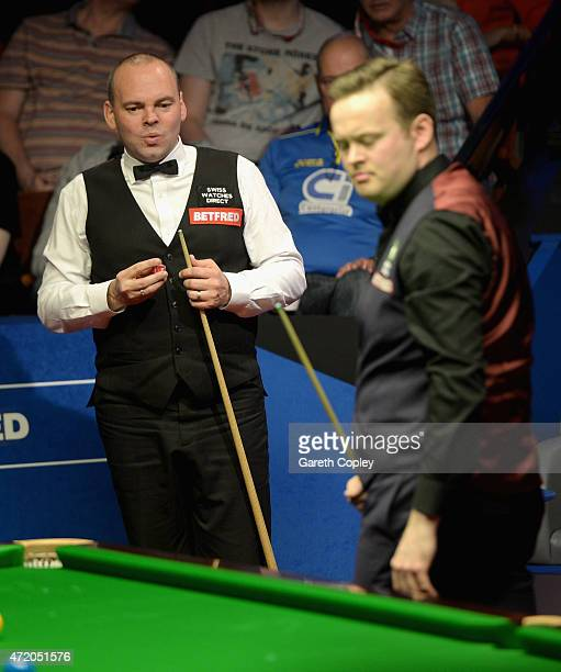 Stuart Bingham lines up a shot against Shaun Murphy during the final of the 2015 Betfred World Snooker Championship at Crucible Theatre on May 3 2015...