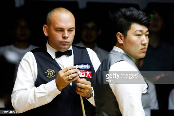 Stuart Bingham of England and Yan Bingtao of China look on during a qualifying match on day one of Evergrande 2017 World Snooker China Champion at...